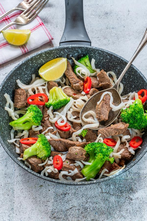 Beef and broccoli noodles stock images