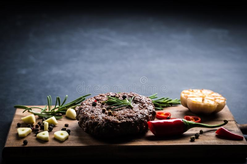 Beef burger cutlet with herbs and spices royalty free stock photos