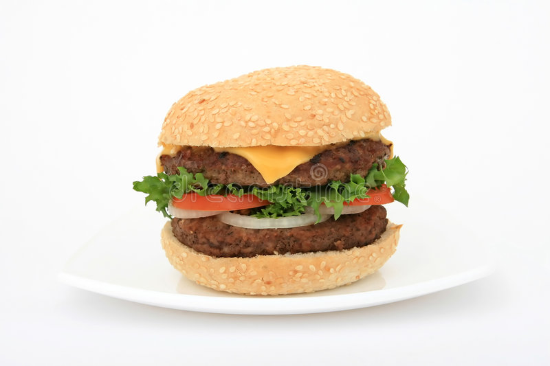 Beef burger over white on a plate