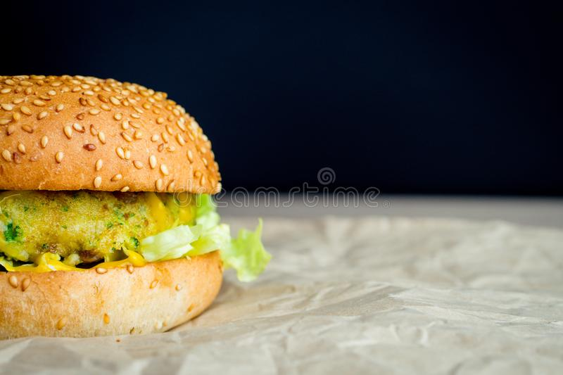 Beef burger with tomato, salad, onion, pepers and cheese royalty free stock photo