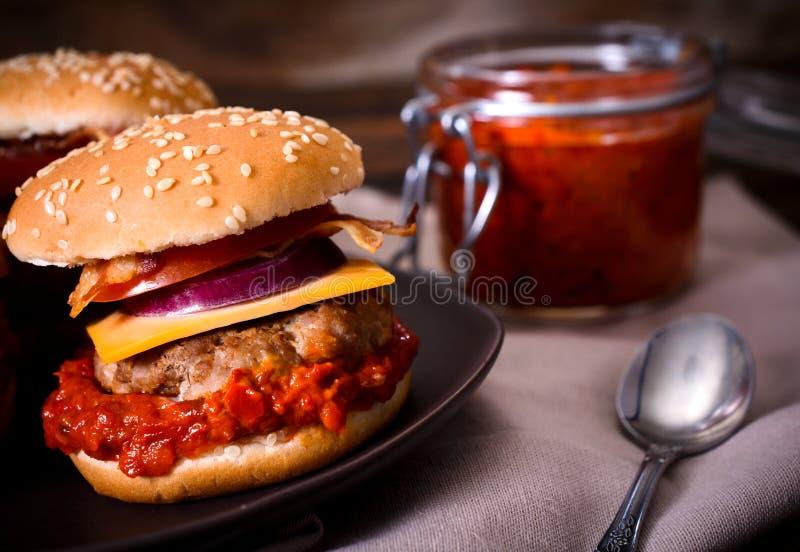 Beef burgers and ajvar salad. Mini beef burger stuffed with ajvar salad,selective focus stock photo