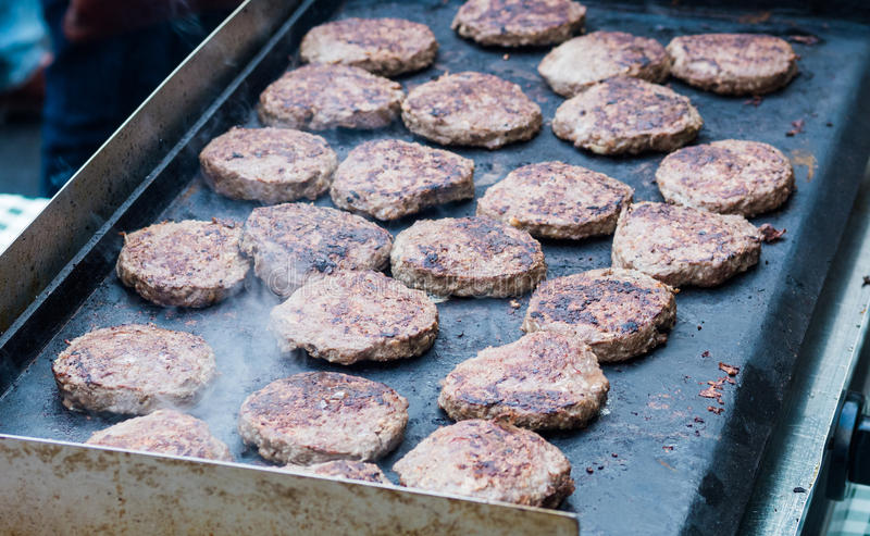 Beef burgers. At a greasy spoon restaurant stock photo
