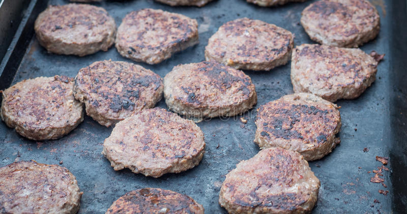 Beef burgers. At a greasy spoon restaurant royalty free stock images