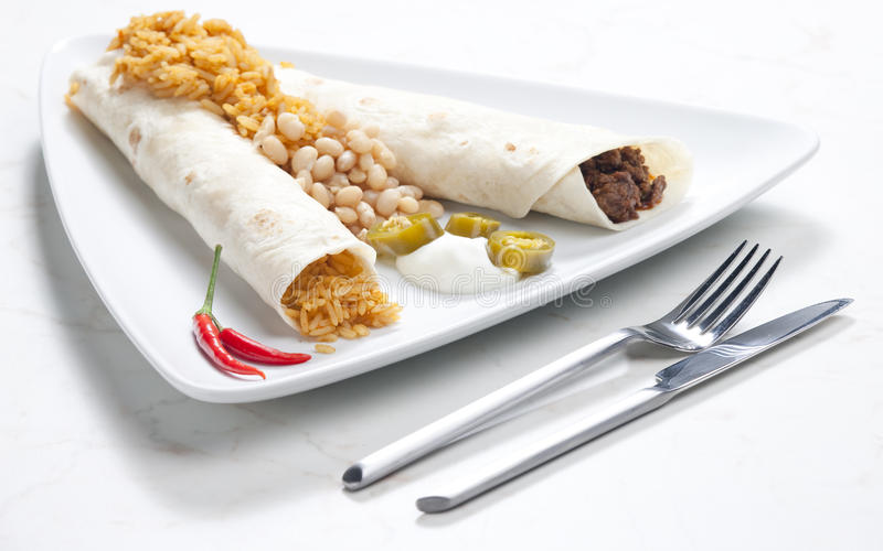 Beef burritos. With beans and rice royalty free stock photography