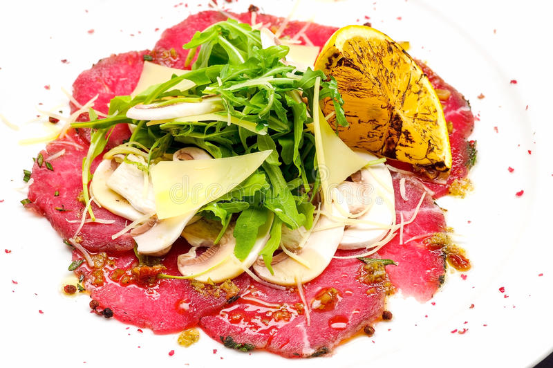 Beef carpaccio with Parmesan cheese stock image