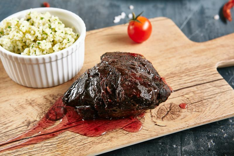 Beef Cheeks with Berry Sauce and Couscous royalty free stock photo