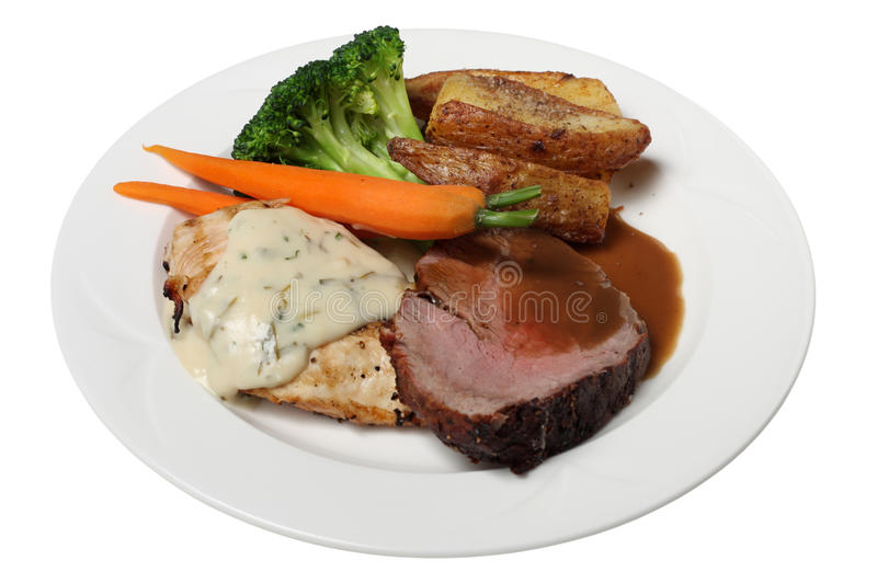 Beef and chicken dinner stock photo