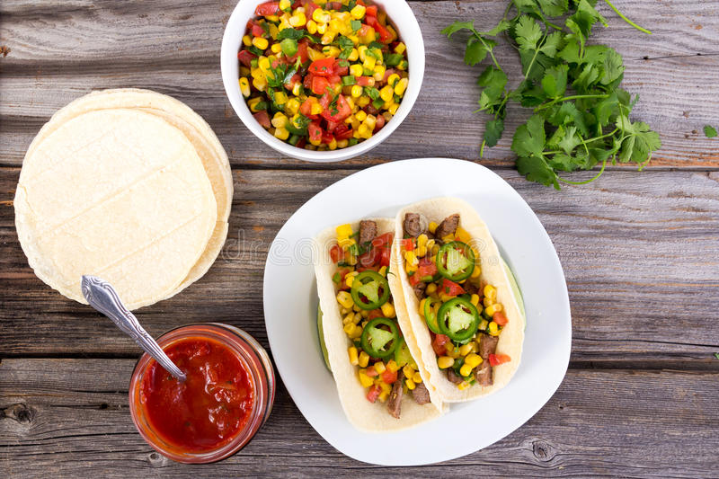 Beef corn soft taco on rustic wood table stock photos