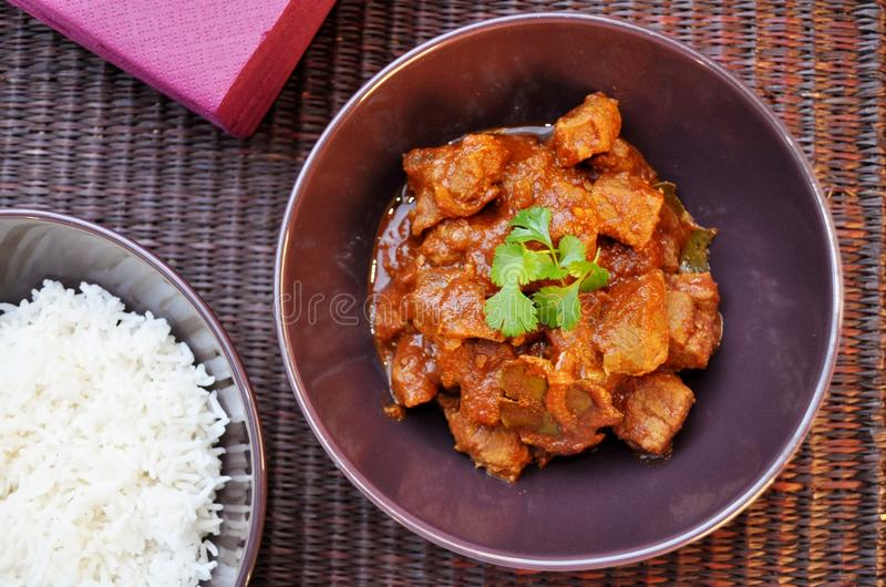 Beef Curry with Rice. Indian beef curry with steamed white rice royalty free stock images