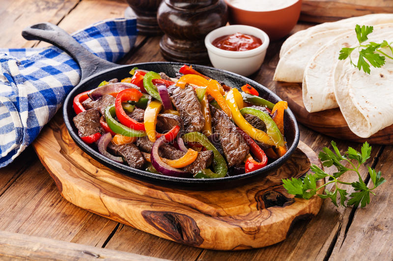 Beef Fajitas, tortilla bread and sauces stock photo