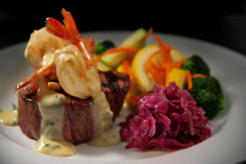 Beef Filet Mignon with Shrimp and Veggies royalty free stock photography