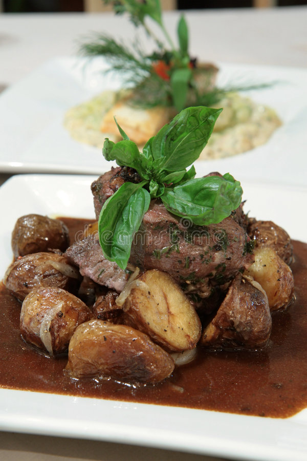 Beef fillet in black pepper sauce stock photography