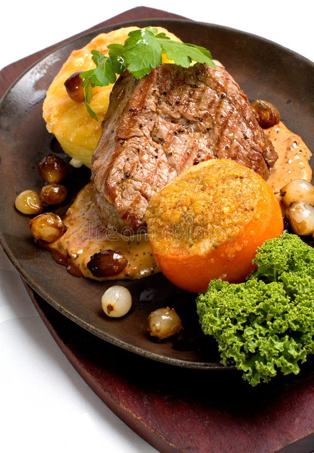 Beef fillet and garlic gratin stock image