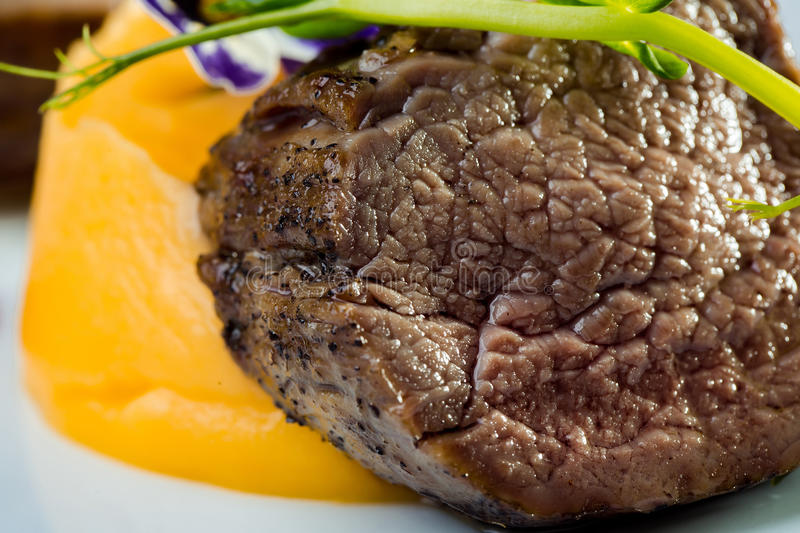 Beef fillet mignon. Beef medallion fillet steak mignon tasty juicy and roasted meat main dish on white background stock photos