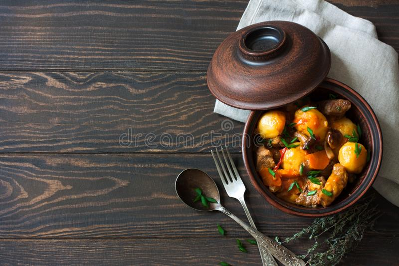 Beef Goulash with Potatoes, Carrots and Mushrooms. On Dark Wood Background. Top View royalty free stock image