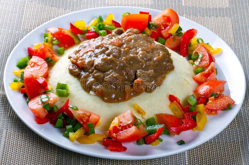 Beef goulash with potatoes and vegetables