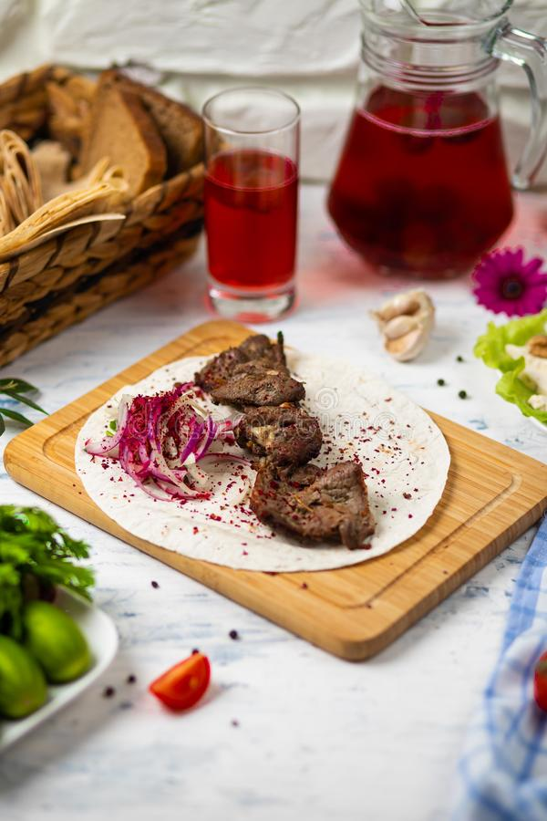 Beef meat kebab with onions, sumakh. royalty free stock photography