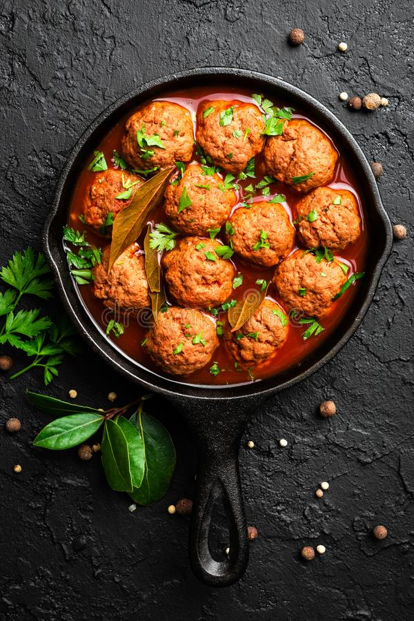 Beef meatballs in tomato sauce stock photography