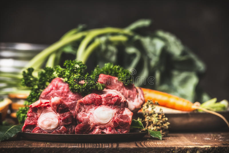 Beef Ox tail meat with bone and cooking ingredients for soup or broth royalty free stock photography