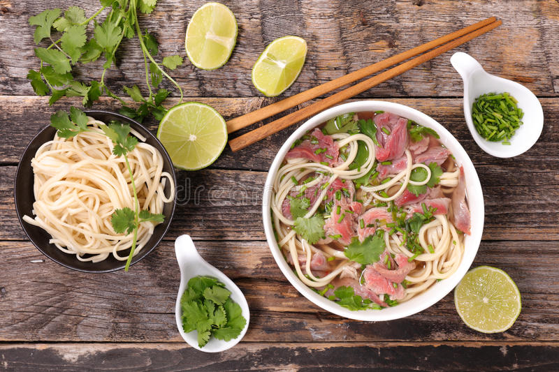 Beef pho and ingredient. On wood stock photo