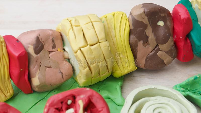 Beef and pork with vegetable mold clay sculpture create of BBQ a stock photo