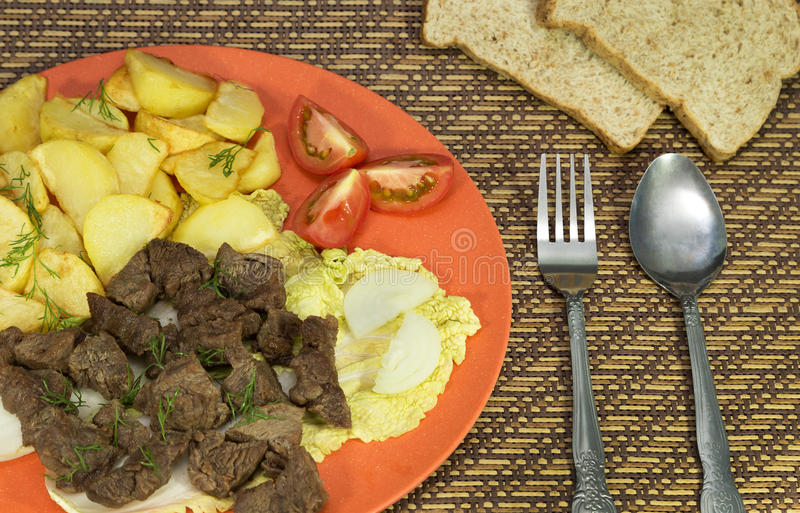 Beef with potatoes meal. The picture of served meal royalty free stock images