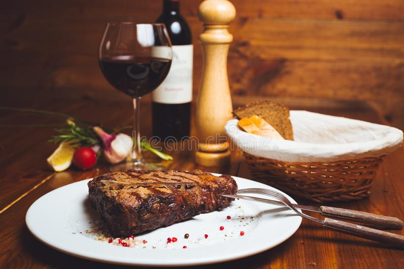 Beef rib eye on a served table royalty free stock image