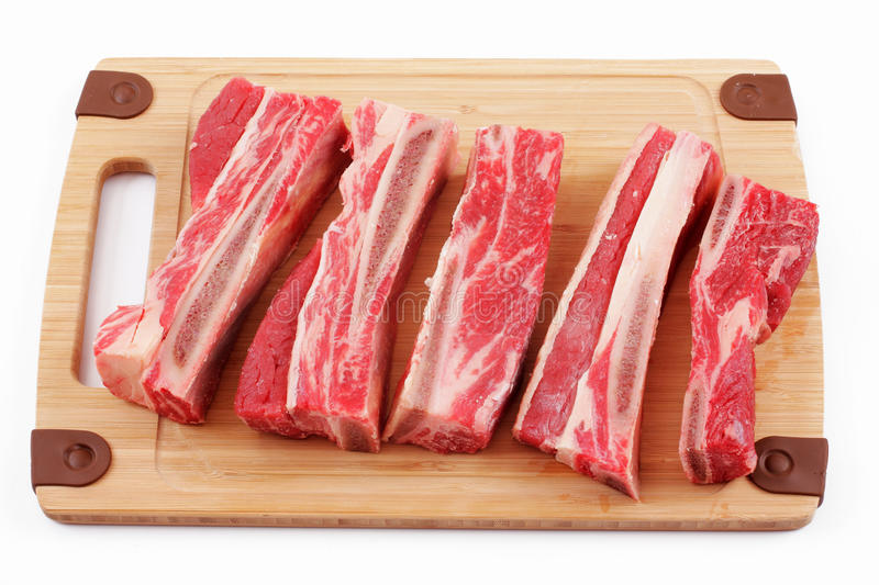 Beef ribs. Over white, studio isolated royalty free stock photography