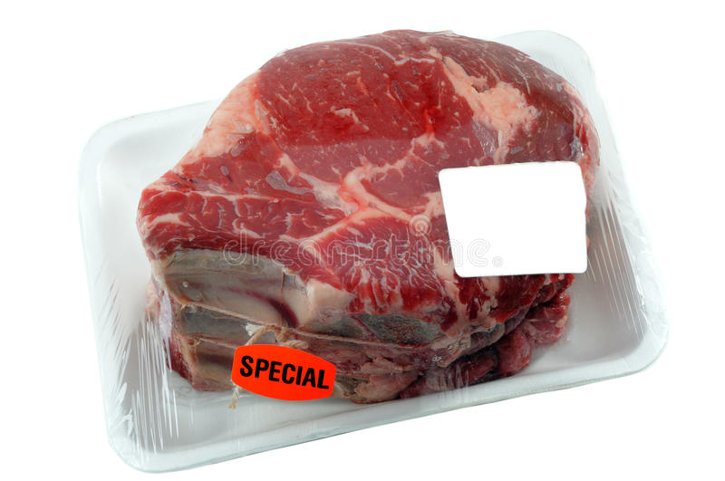 Beef Roast. Beef Prime Rib Roast In Supermarket packaging With Blank Label For Your Design stock image