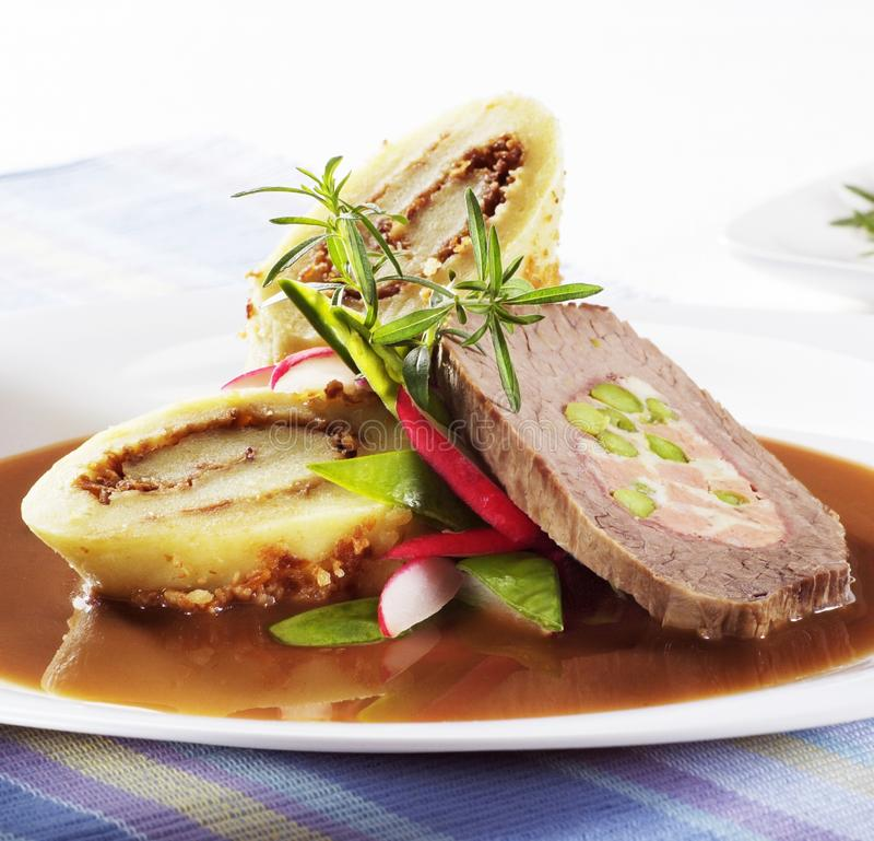 Beef roll with potato dumplings. Slice of beef roll with filled potato dumplings royalty free stock photo