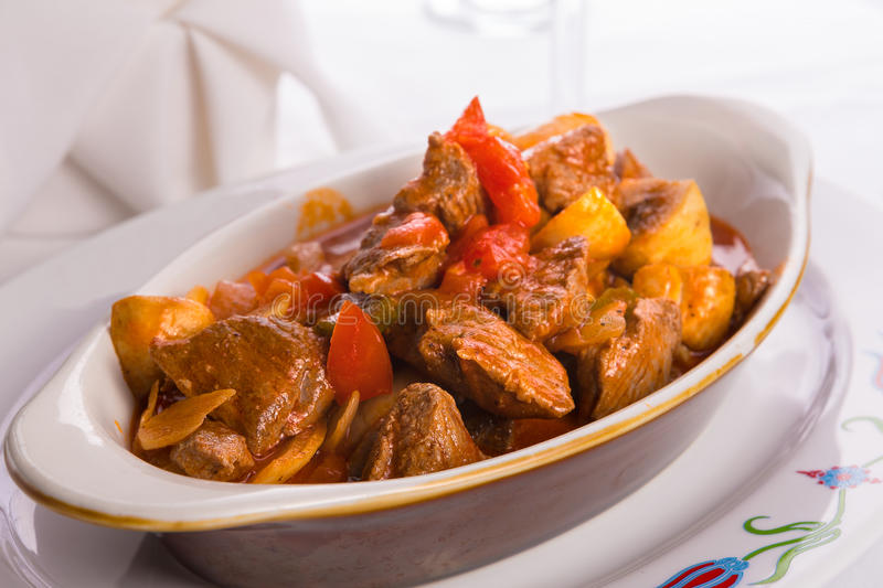 Beef Saute in Oval Baking Dish. Beef Saute with Tomatoes, mushrooms and onions served in oval baking dish stock images
