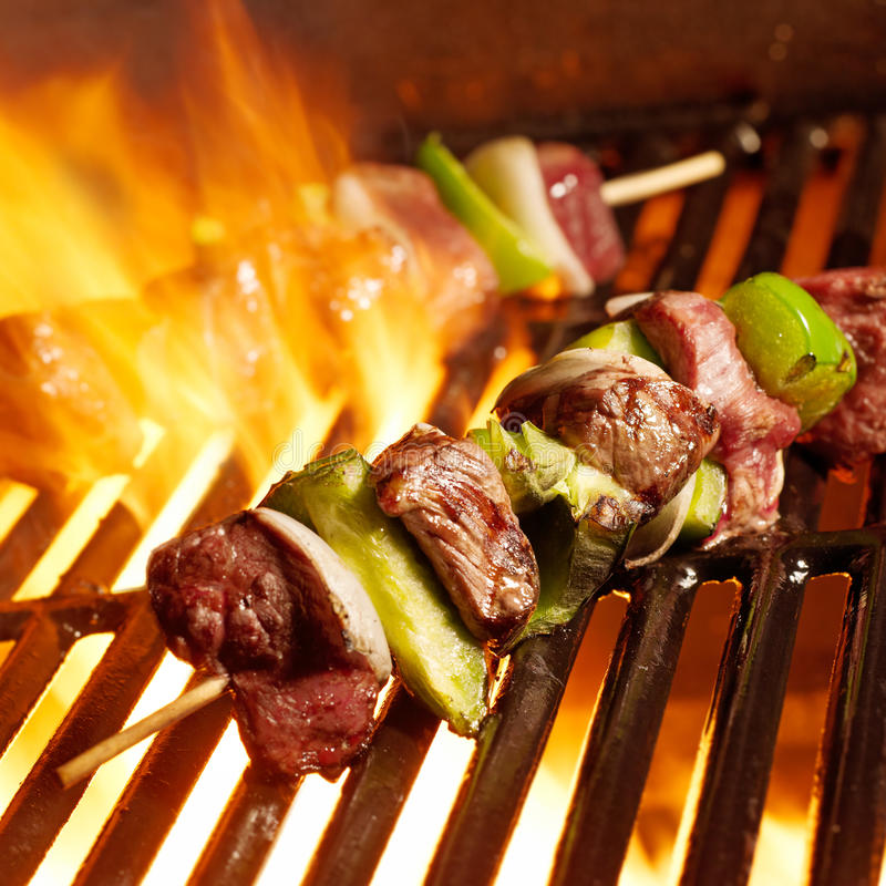 Beef shish kabobs on the grill royalty free stock photos