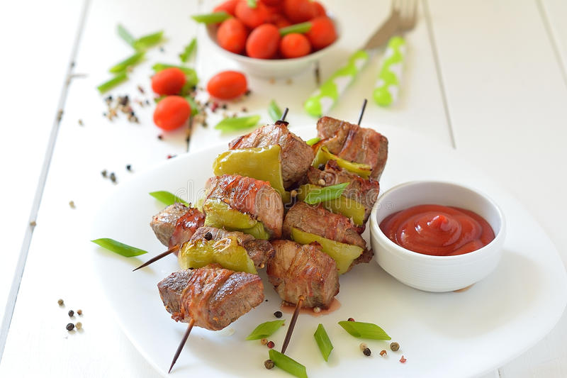 Beef shish kebab skewers on a plate royalty free stock image