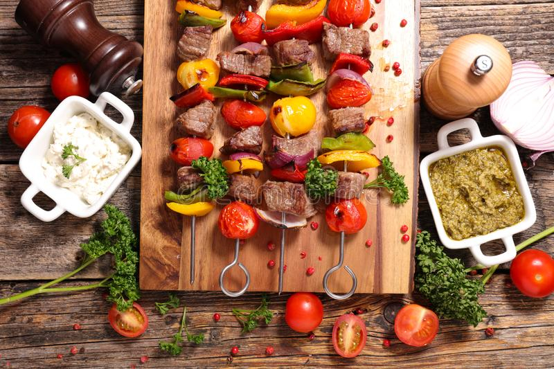 Beef skewer barbecue. On wood royalty free stock photography