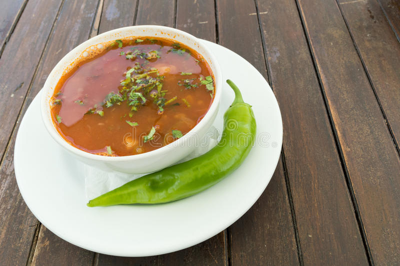 Beef soup with raw green pepper stock photos