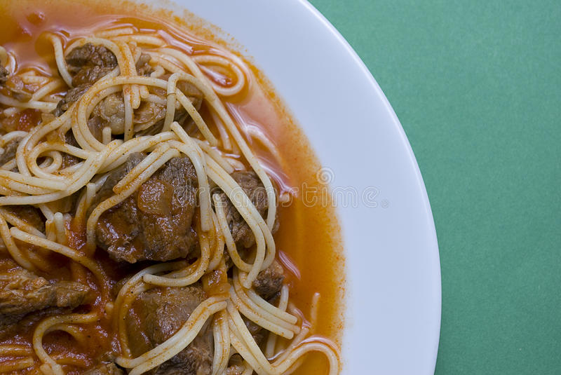 Beef and spaghettis in a sauce royalty free stock photography