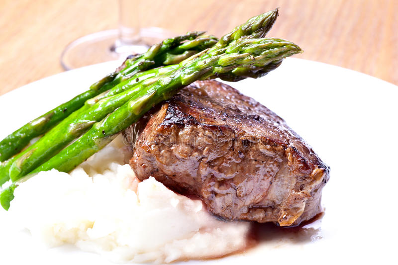 Beef stake with asparagus. On a plate - horizontal stock photos