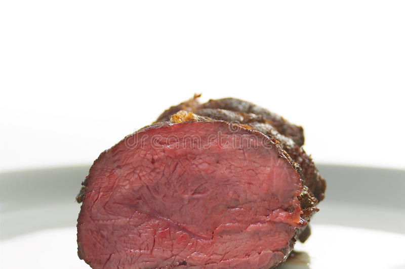 Beef steak. A piece of beef steak placed on white plate stock photography