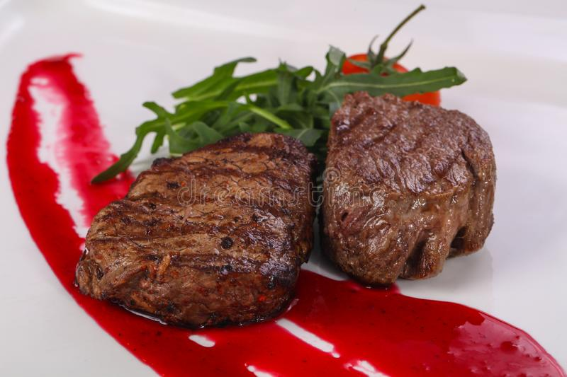 Beef steak with berry sauce stock image