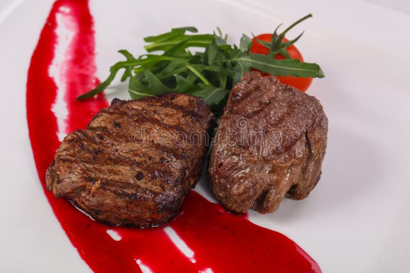 Beef steak with berry sauce stock images