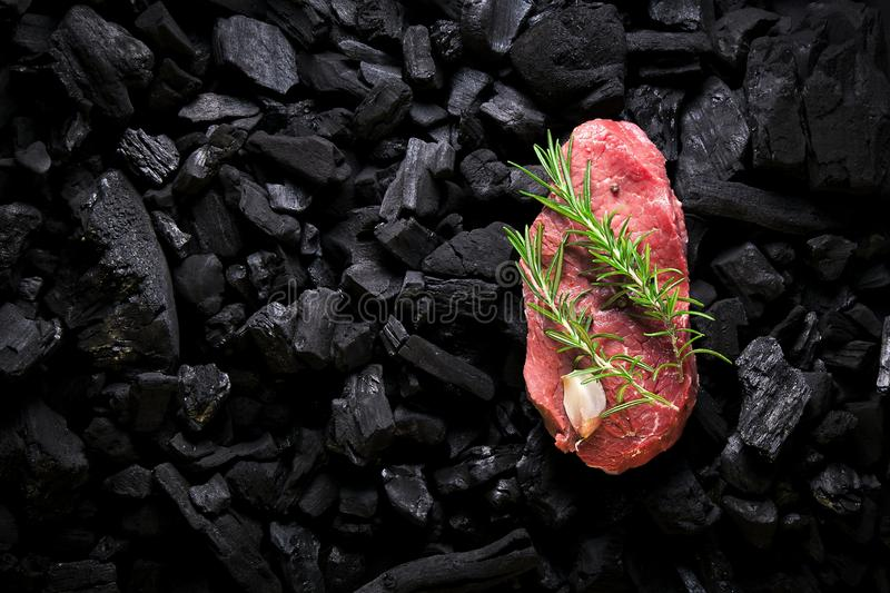 Beef steak on the charcoal. product photo, place for your advertisment stock image