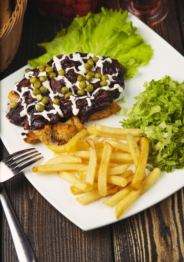 Beef steak with french fries, green salad, green beans and chicken nuggets. Image stock photo