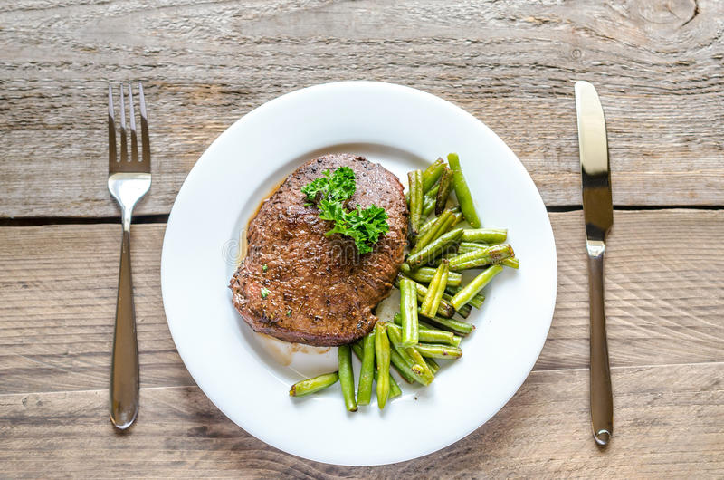 Beef Steak with green beans. Close Up stock images
