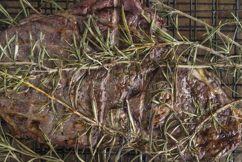 Beef steak grilled with rosemary on the barbecue royalty free stock photos