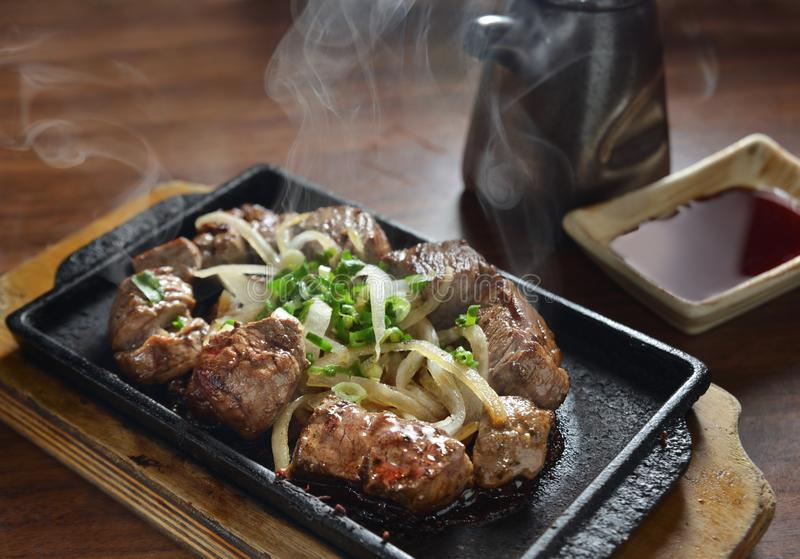 Beef steak hot pan. Grilled prime beef steak on hot pan royalty free stock photography