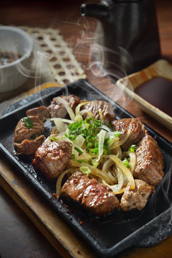 Beef steak hot pan. Grilled prime beef steak on hot pan royalty free stock photo