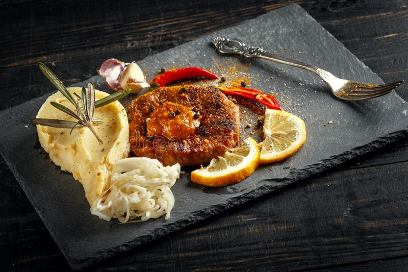 Beef steak with mashed potatoes, spices and sauce. Meat grilled food meal sirloin tenderloin roasted dinner cooking tasty pepper prepared barbecue fillet royalty free stock photos