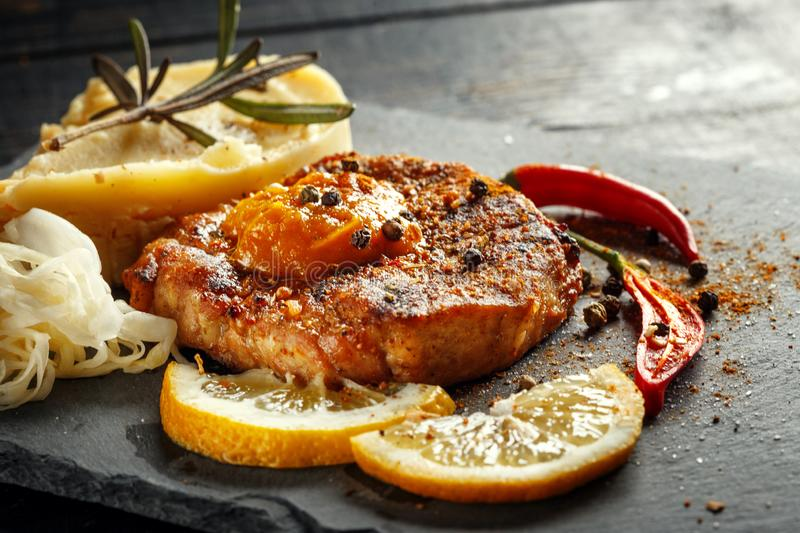 Beef steak with mashed potatoes, spices and sauce. Meat grilled food meal sirloin tenderloin roasted dinner cooking tasty pepper prepared barbecue fillet stock photos