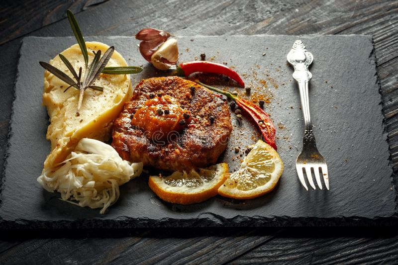 Beef steak with mashed potatoes, spices and sauce. Meat grilled food meal sirloin tenderloin roasted dinner cooking tasty pepper prepared barbecue fillet royalty free stock images