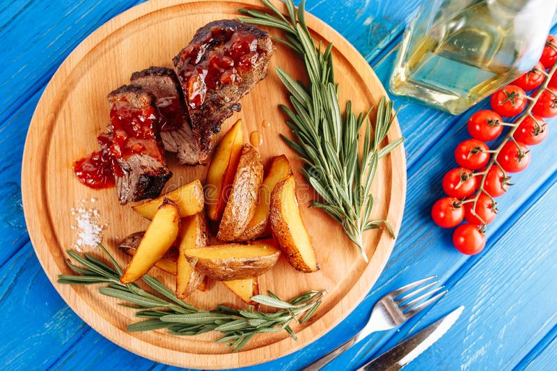 Beef Steak Meat Grilled Potato Top Down Flatlay royalty free stock image